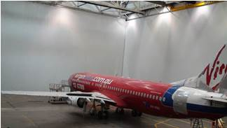 A 737 aircraft painting area designed, manufactured on site and installed at Tullamarine for John Holland Aviation. 2 curtains 60 and 40m long x 22m high were used to seal off 30% of a hangar, a further 8m of rafters were sealed above the curtains.