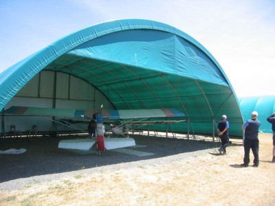 Hangars with partial end walls can reduce the incursion of weather.