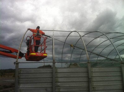 Repairs to a fabric structure which sustained loader damage.