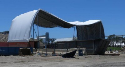 Wind Ratings - a fabric structure which was secured to concrete barrel footings which rolled outward in a severe storm. The arch lost its integrity as the base move outwards and the top became a massive swimming pool crushing the shelter.