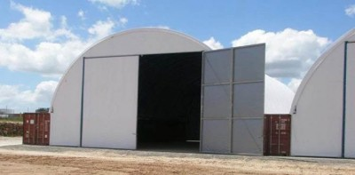 Barn doors for fabric structures are suitable for seldom used or smaller doors.