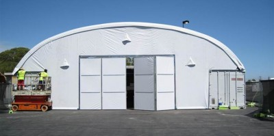 Bi-fold doors for fabric structures are strong, wind resistant and easy to open.