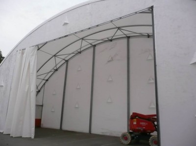 Curtain doors for fabric structures are ideal for constricted areas or where there is little use.