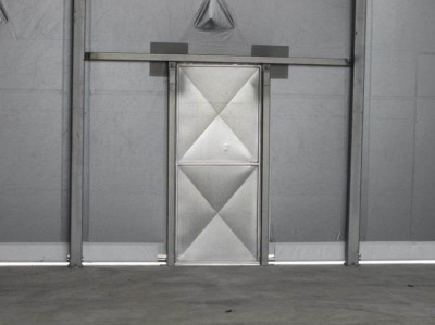Personal access doors for fabric buildings can be made of steel or wood.