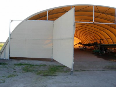 Panel doors for fabric structures are a low cost option to block personnel.