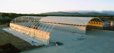 Fabric Roof Systems mounted on concrete walls are ideal for storing loose materials