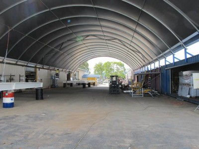 Fabric roof systems increase productivity by providing a cool dry environment for workers.