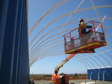Taurus Fabric Build install team at Cape Preston WA installing a 16m (50') wide x 30m (94') long structure.