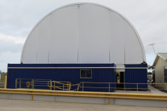 Truck depot container mounted fabric structure