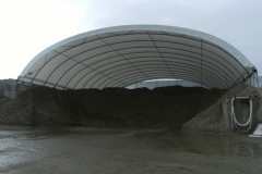 Concrete block dry wall fabric structures for bulk storage