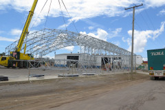 Bracing between sections of large fabric structures