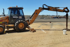 Using a backhoe with an auger extension for 2.4m holes