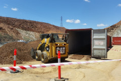 Bobcat filling containers with ballast material Mount Isa Mines