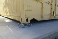 Twist-locks chemset to reinforced slab to secure fabric structures
