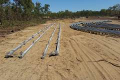 Laying out at Truscott WA, rails to be welded to containers, internal & external edges, to take frames