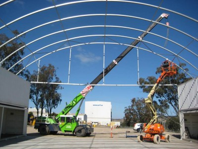 21m wide fabric structure installation with partial end wall.