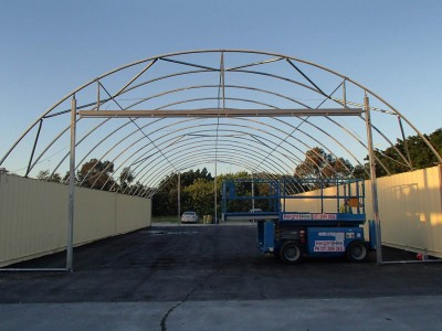 Full end wall with doorway frame 12m wide structure.