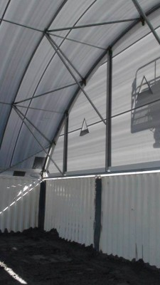 Partial end wall fitted above an end container.