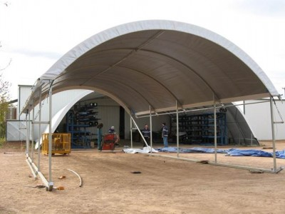 Mobile fabric structures can be mounted on skids