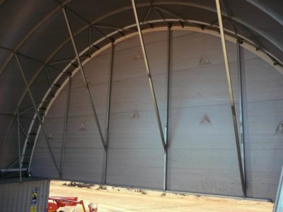 Installing dome building end walls.