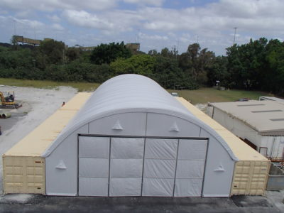 Fabric structure gallery - Dome building on shipping containers